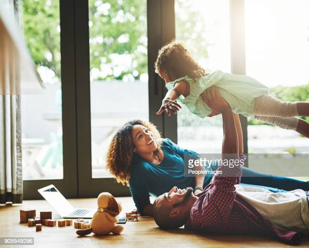 bonding at home - happy family stock photos and pictures