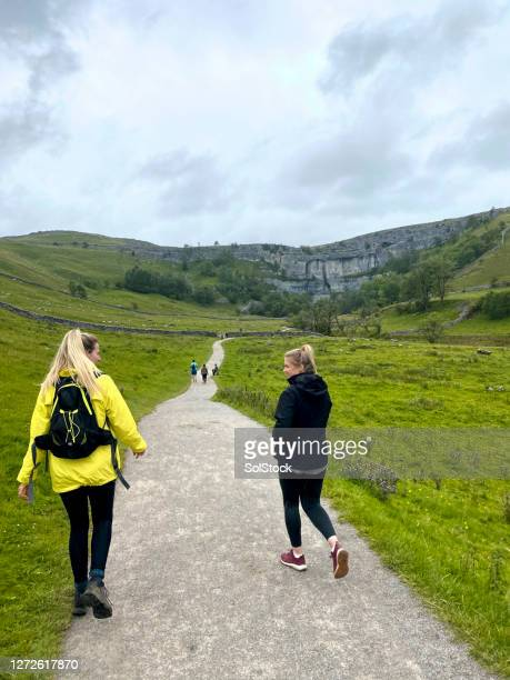 bonding in the countryside - mid adult women stock pictures, royalty-free photos & images