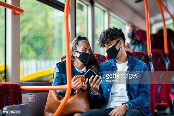bonding over social media - public transport stock pictures, royalty-free photos & images