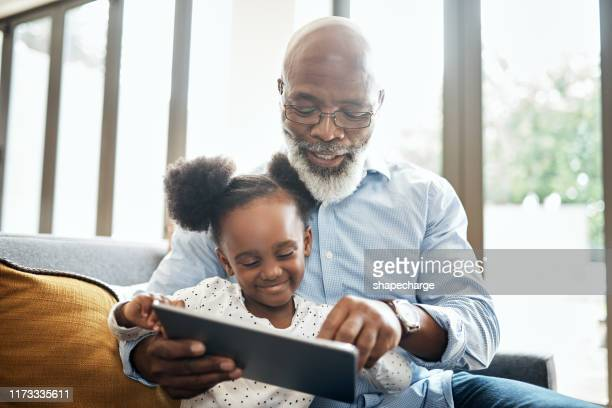 bonding while playing in the modern age - grandparent stock pictures, royalty-free photos & images