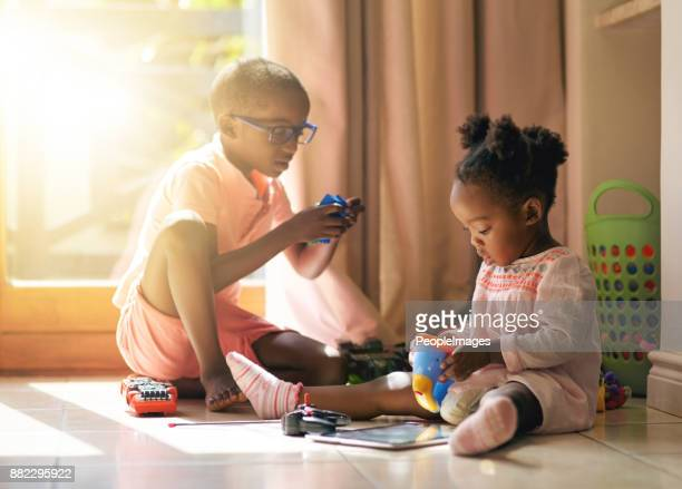 bonding with her brother - sibling stock photos and pictures