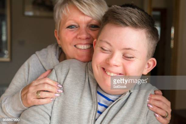 bonding with his mother - down syndrome stock pictures, royalty-free photos & images