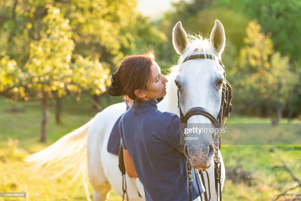 Bonding with horse : Stock Photo
