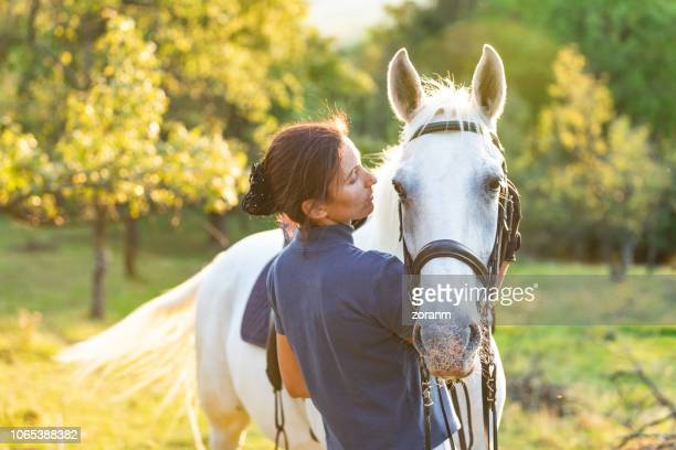 bonding with horse - andare a cavallo foto e immagini stock