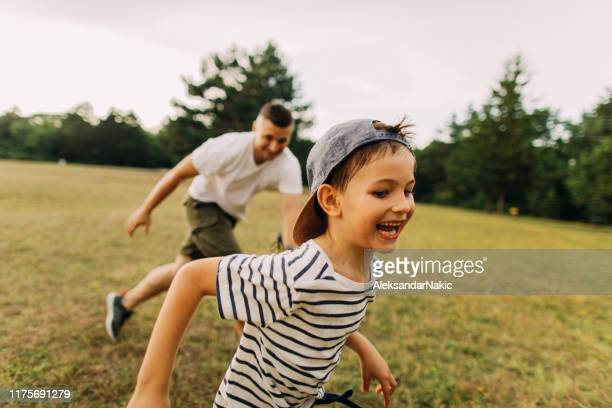 bonding with my dad - football league stock pictures, royalty-free photos & images