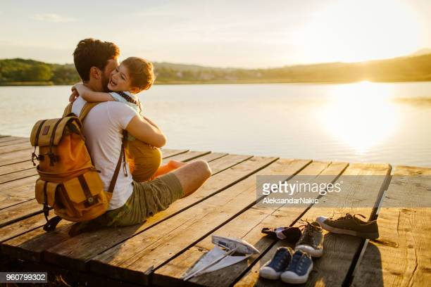 bonding with my son - sunset lake stock photos and pictures