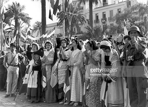 Bone Algeria young women dressed in regional outfits from the French provinces wait for General DE GAULLE to pass by during his visit to Algeria