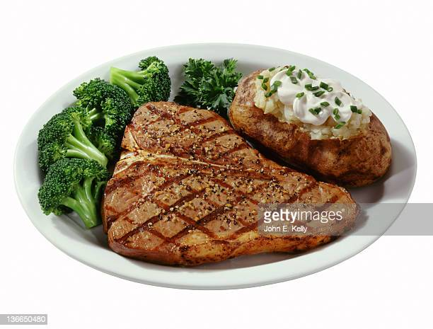 T bone steak with baked potato and broccoli