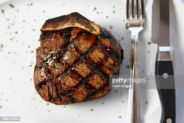 bone-in filet - steakhouse stock photos and pictures
