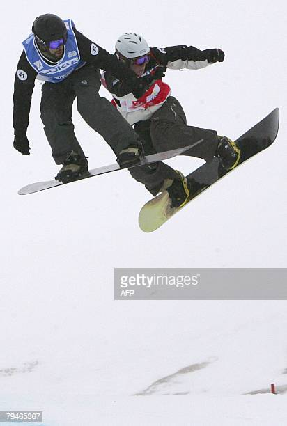 Bonenfant Simon and Mike Robertson from Canada compete on the Snowboard Cross at the FIS World cup in Leysin 01 February 2008 Austria's Mario Fuchs...