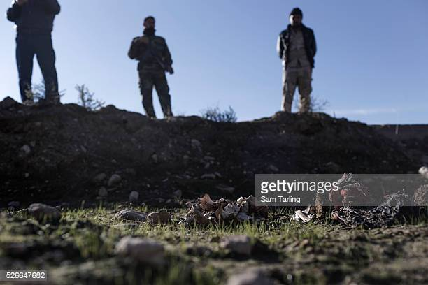 Bones hair and traditional Yazidi garb are seen at the site of a suspected mass grave outside the Institute of Technology some 5 km East of the town...