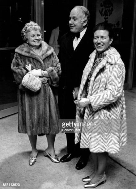 Bonfils Theatre Opens Thursday Mr and Mrs Benjamin Stapleton Jr left and Mrs Robert W Cleghorn arrive for Thursday opening of Broadway hit Under the...