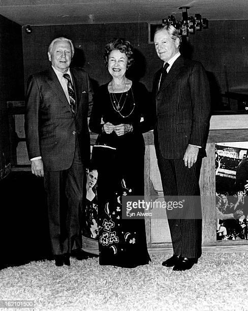 SEP 26 1977 SEP 27 1977 Bonfils Theatre Plans Open House ***** Sunday Mr and Mrs Francis Van Derbur left and Donald R Seawell discuss the Bonfils...