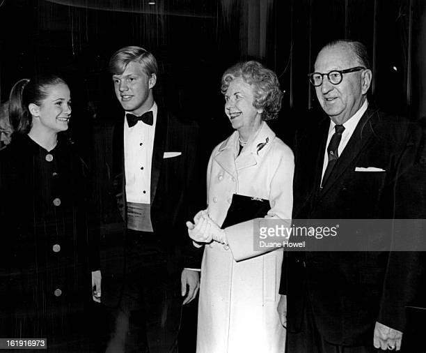 JAN 19 1966 Bonfils Theatregoers out to see Dark of the Moon Miss Marne Davis and her date Sandy Smith stop to chat with Mr and Mrs William E Glass...