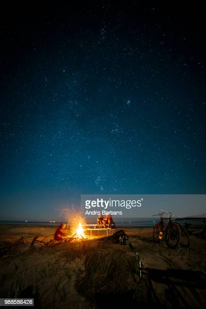 a bonfire at a beach in latvia. - bonfire stock photos and pictures