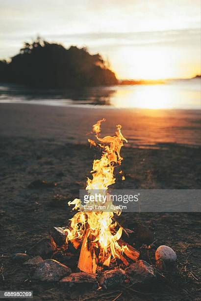 Bonfire At Beach Against Sky During Sunset