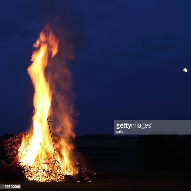 Bonfire at midsummer with moon in the sky