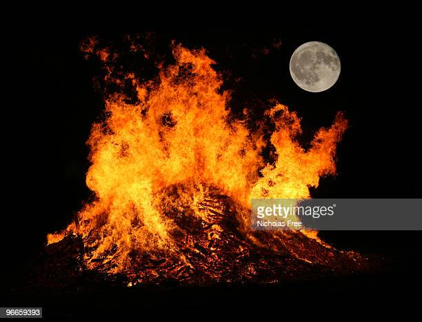 bonfire by mooonlight - bonfire stock photos and pictures