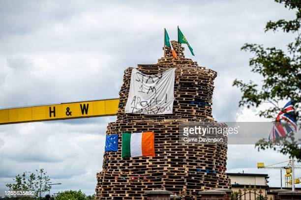A bonfire displays a banner asking people to maintain social distancing on Newtownards Road on July 11 2020 in Belfast Northern Ireland In an effort...