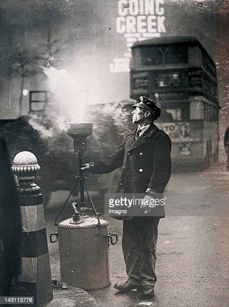 Bonfire in the dense fog of Wellington Street in London Photograph 1937