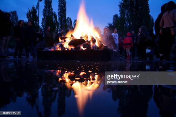 A bonfire is set alight during the traditional Walpurgis Night event at the Mauerpark in Berlin Germany 30 April 2015 Photo Kay Nietfeld/dpa | usage...