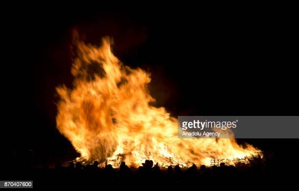 Bonfire lit up by The Waterloo society is seen in town of Lewes East Sussex England during the annual bonfire night procession is held by the Lewes...