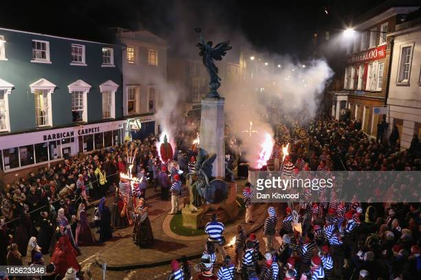 Bonfire societies gather around the war memorial for prayers during the Bonfire Night celebrations on November 5 2012 in Lewes Sussex in England...