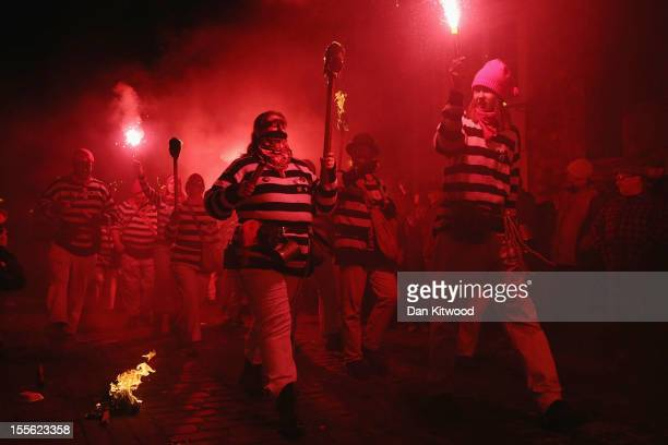 Bonfire societies parade through the streets during the Bonfire Night celebrations on November 5 2012 in Lewes Sussex in England Bonfire Night is...