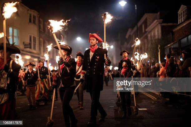 Bonfire societies parade through the streets during traditional Bonfire Night celebrations on November 05 2018 in Lewes England The night's events...