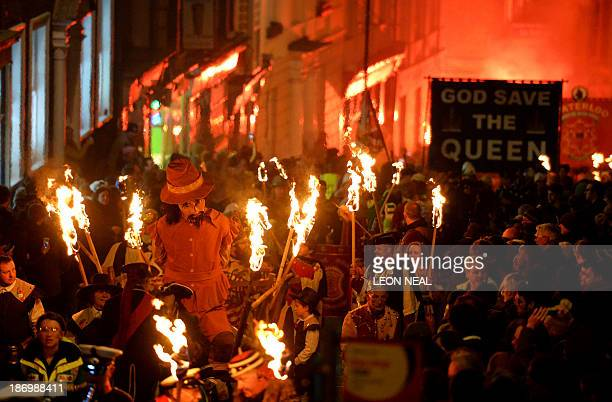 Bonfire societies parade through the streets with an effigy of Guy Fawkes during the Bonfire Night celebrations on November 5 2013 in Lewes Sussex in...