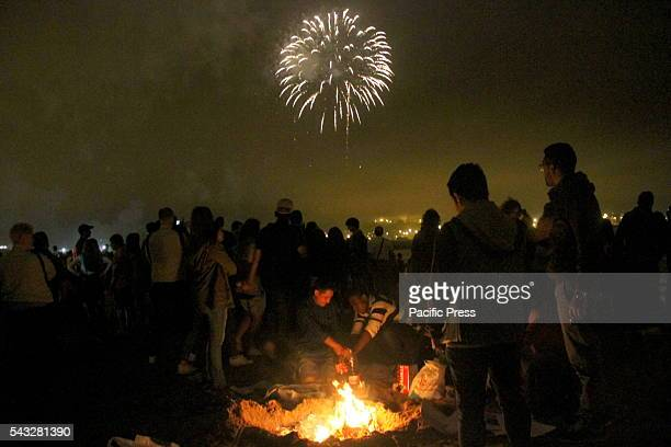 Bonfires lit up the west beach of Poniente in Gijon during the magical night of Saint John's with thousands of people celebrating in the sand.