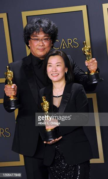 Bong Joon Ho and Kwak Sin-ae pose with his Award for Best Picture and Best International Feature inside The Press Room of the 92nd Annual Academy...