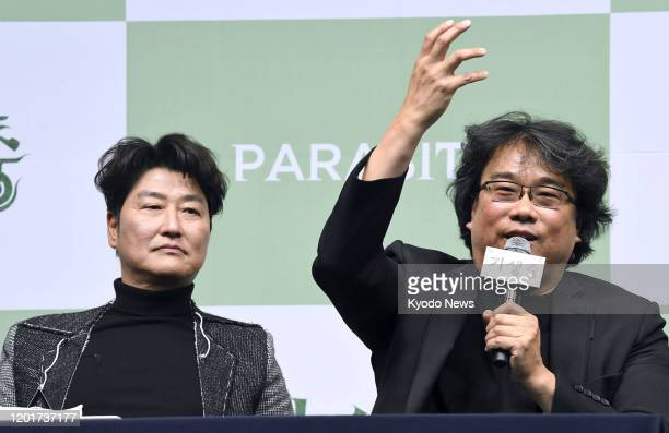"""Bong Joon Ho , director of the Oscar-winning film """"Parasite,"""" speaks at a press conference in Seoul on Feb. 19 alongside actor Song Kang Ho."""