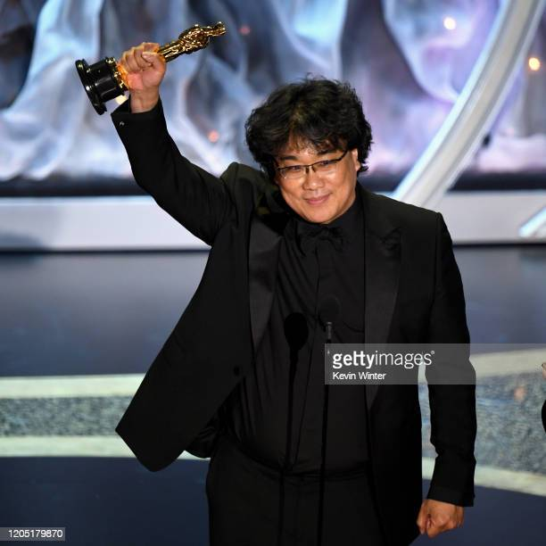 Bong Joonho accepts the International Feature Film award for 'Parasite' onstage during the 92nd Annual Academy Awards at Dolby Theatre on February 09...