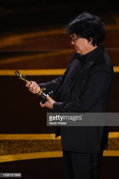 Bong Joon-ho accepts the Writing - Original Screenplay - award for 'Parasite' onstage during the 92nd Annual Academy Awards at Dolby Theatre on...