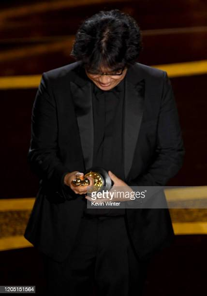 Bong Joonho accepts the Writing Original Screenplay award for 'Parasite' onstage during the 92nd Annual Academy Awards at Dolby Theatre on February...
