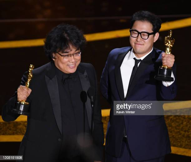 Bong Joon-ho and Han Jin-won accept the Writing - Original Screenplay - award for 'Parasite' onstage during the 92nd Annual Academy Awards at Dolby...