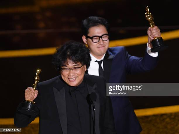 Bong Joonho and Han Jinwon accept the Writing Original Screenplay award for 'Parasite' onstage during the 92nd Annual Academy Awards at Dolby Theatre...