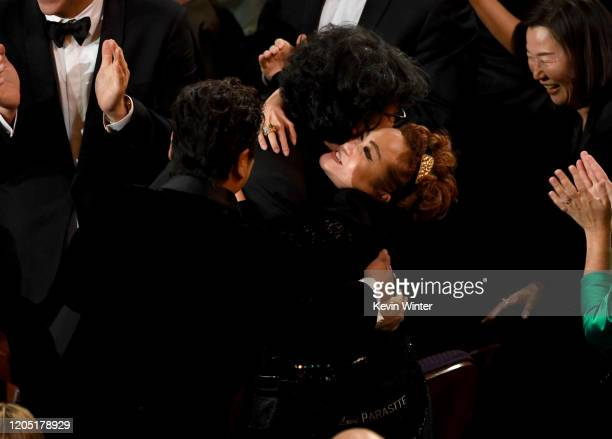 Bong Joonho and Miky Lee react after 'Parasite' was named winner of the Best Picture award during the 92nd Annual Academy Awards at Dolby Theatre on...