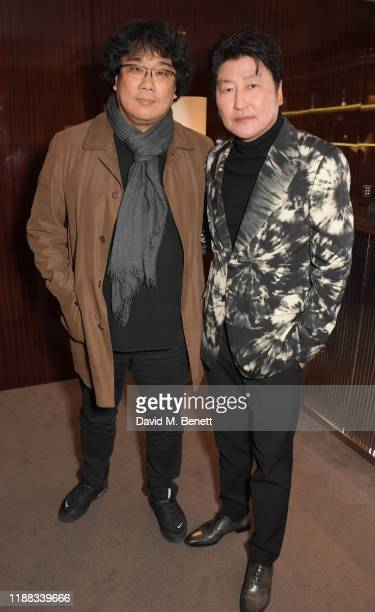 Bong Joonho and Song KangHo attend an AMPAS screening of Parasite at The Bulgari Hotel on December 13 2019 in London England