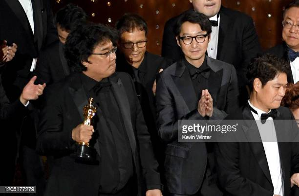 Bong Joonho and Yang Jinmo accept the Best Picture award for 'Parasite' onstage during the 92nd Annual Academy Awards at Dolby Theatre on February 09...