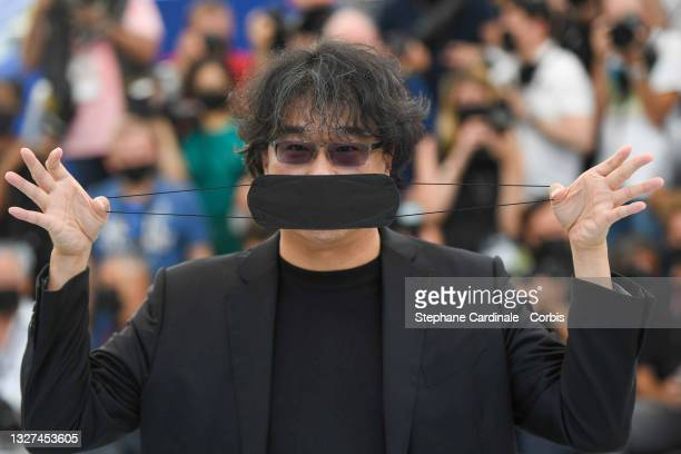 """Bong Joon-Ho attends """"Bong Joon-Ho"""" photocall during the 74th annual Cannes Film Festival on July 07, 2021 in Cannes, France."""