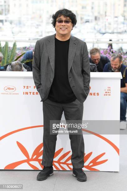 Bong JoonHo attends the photocall for Parasite during the 72nd annual Cannes Film Festival on May 22 2019 in Cannes France