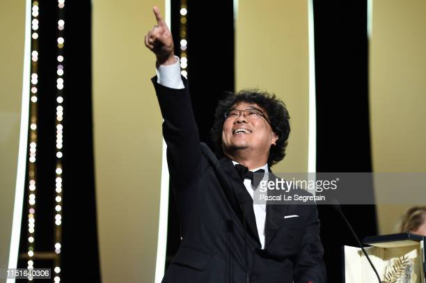 Bong JoonHo celebrates after receiving the Palme d'Or award for the film Parasite at the Closing Ceremony during the 72nd annual Cannes Film Festival...