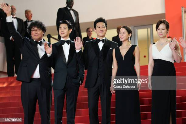 Bong JoonHo Choi WooShik Lee SunKyun Cho YeoJeong and Chang HyaeJin attend the screening of Parasite during the 72nd annual Cannes Film Festival on...