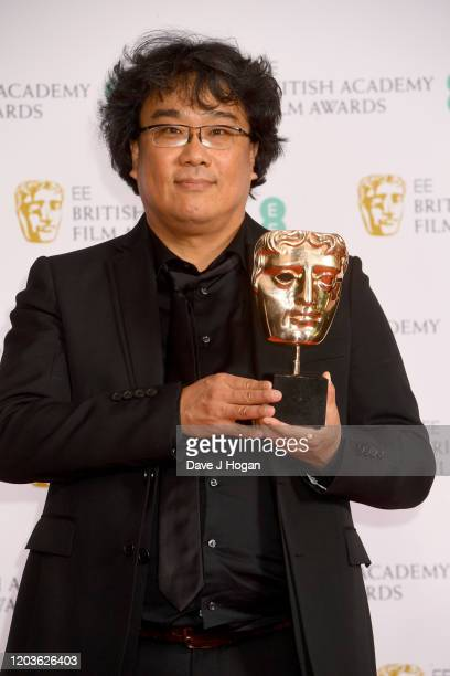 Bong Joon-ho collects the Bafta Award for Parasite, which won awards for Original Screenplay and Film Not in the English Language, in the Winners...