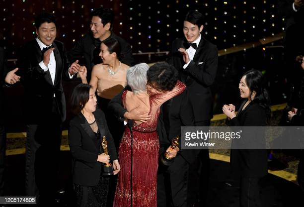 Bong Joon-ho , fellow crew, and cast members accept the Best Picture award for 'Parasite' onstage during the 92nd Annual Academy Awards at Dolby...