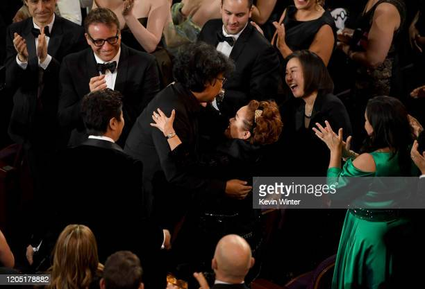 Bong Joonho Miky Lee and Kwak Sinae react after 'Parasite' was named winner of the Best Picture award during the 92nd Annual Academy Awards at Dolby...
