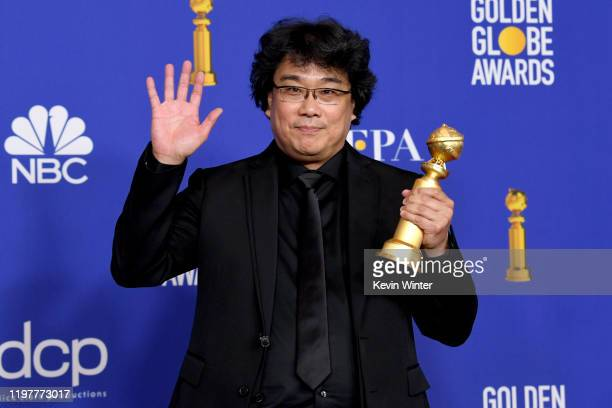 "Bong Joon-ho poses in the press room with award for Best Motion Picture - Foreign Language for ""Parasite"" during the 77th Annual Golden Globe Awards..."