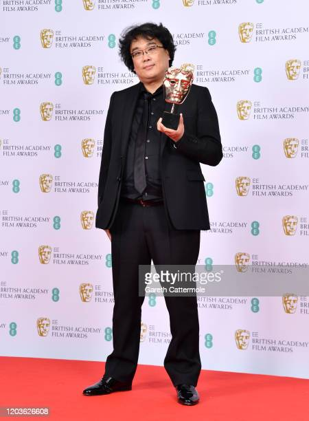 """Bong Joon-ho, who won awards for Best Original Screenplay and Best film not in the English language for """"Parasite"""" poses in the Winners Room during..."""